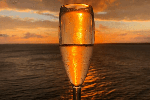 Champagne at Sunset on a Cruise