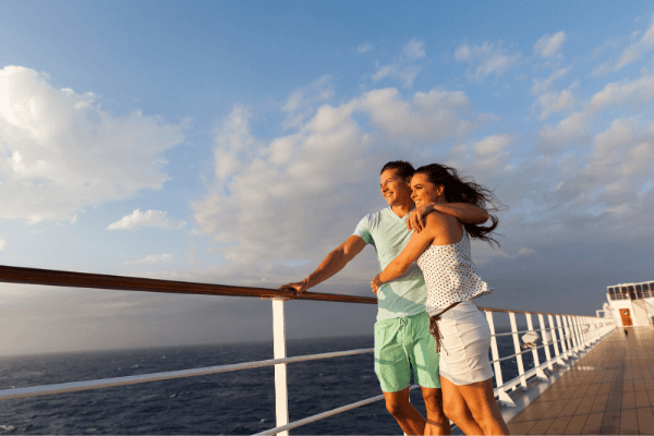 Couple standing on cruise desk not getting sick