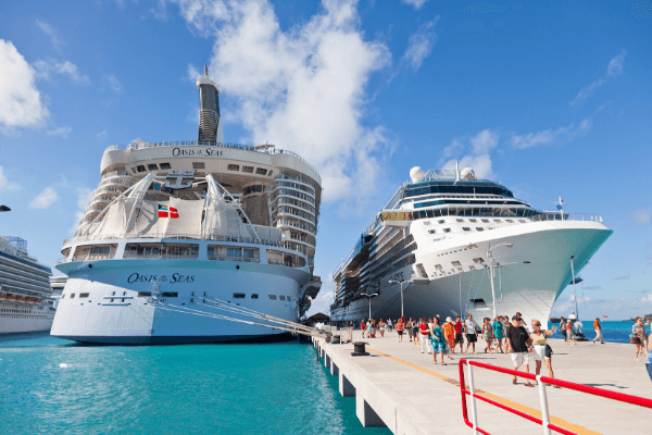 what changes will we see when cruises resume - 2 cruise ships in port with many people