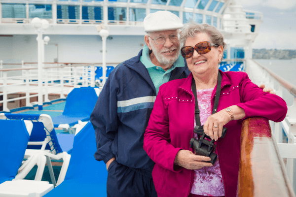 Cruise lines remove travel restrictions age 70 and older - Senior couple cruising