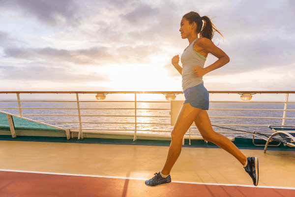 Cruise hacks to manage weight gain - jogging woman on cruise ship