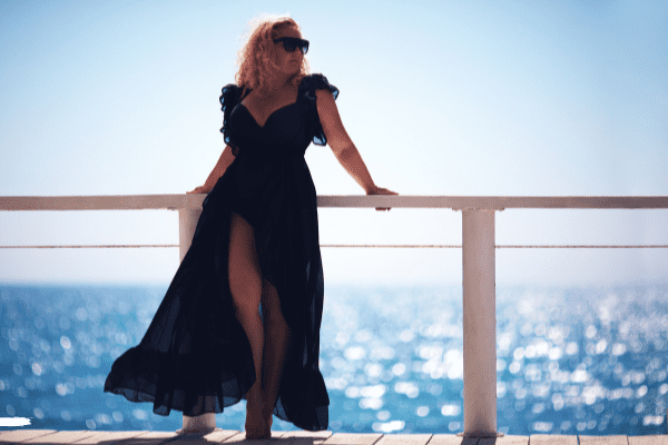 Plus size woman in dress on cruise