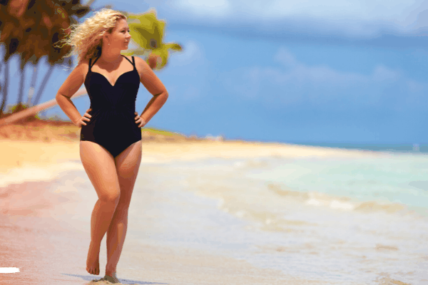 Plus size woman on beach