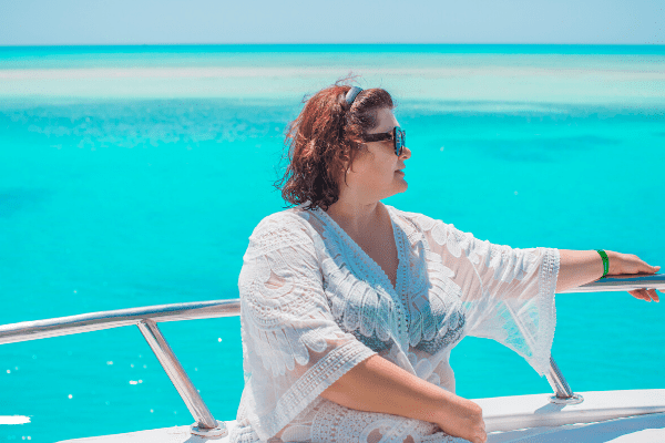 Plus size woman on cruise - bathing suit and cover up
